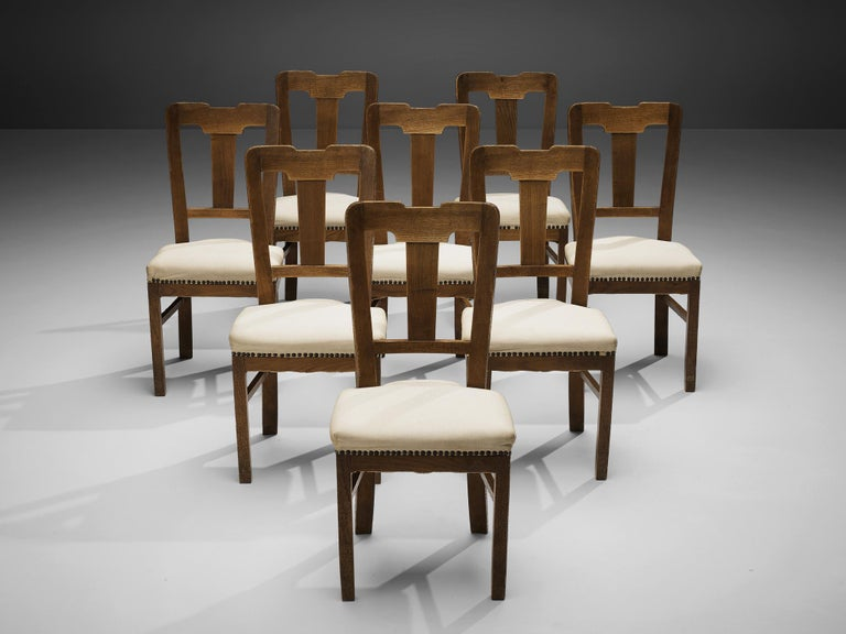 Ernesto Valabrega, set of eight dining chairs, stained oak, fabric upholstery, Italy, ca. 1935  This set of dining chairs by Ernesto Valabrega not only shows a well-balanced backrest but also lovely details like the brass nails holding the seating