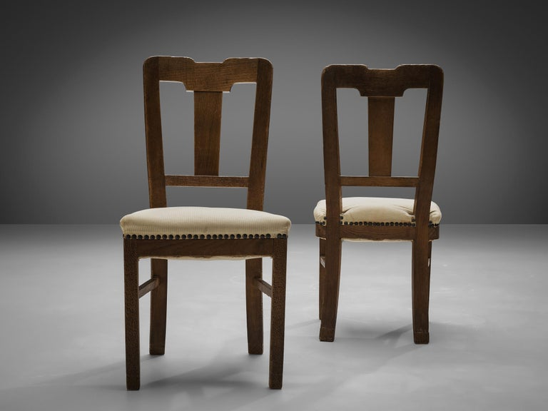 Mid-20th Century Set of Eight Dining Chairs in Oak by Ernesto Valabrega For Sale