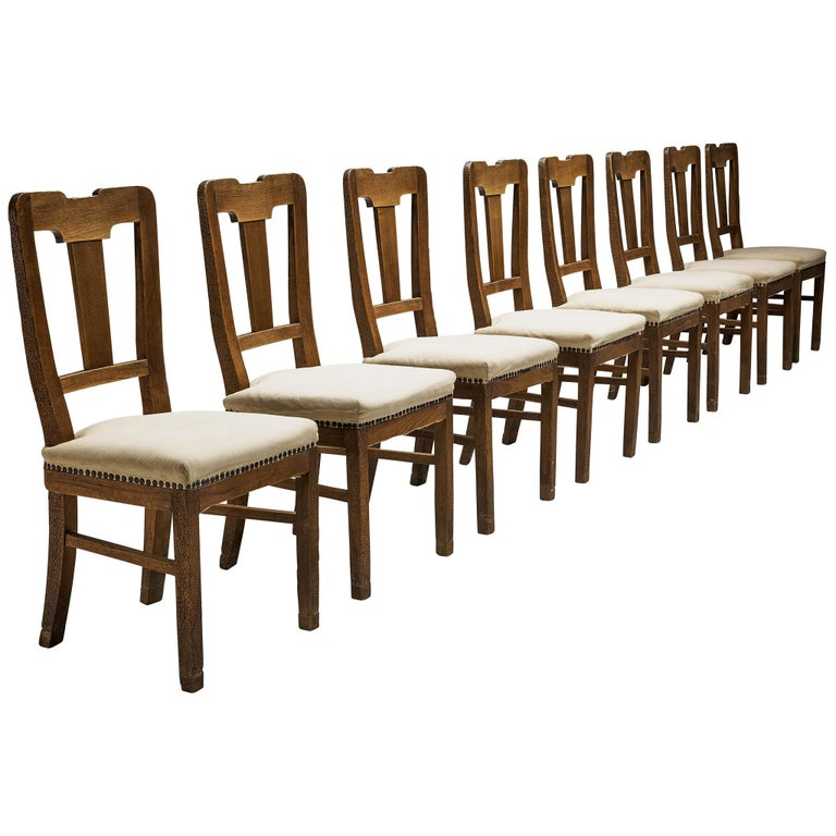 Set of Eight Dining Chairs in Oak by Ernesto Valabrega For Sale