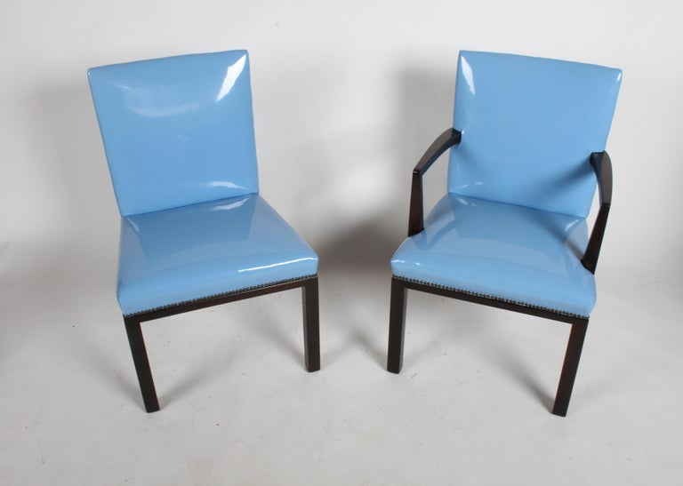 Amazing set of eight Edward J. Wormley for Dunbar dining chairs from one owner estate. All original set, includes dark mahogany frames with blue high quality vinyl seats. There are no tears or rips to upholstery, there are scuffs to legs, expected