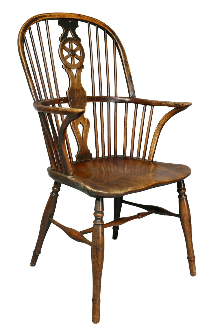 Very well matched set with one chair slightly different, comprising two-arm and six sides. Arched backs with wheel splat, shaped seat, turned tapered legs with H stretchers. Made originally in the Wycombe area of Buckinghamshire.