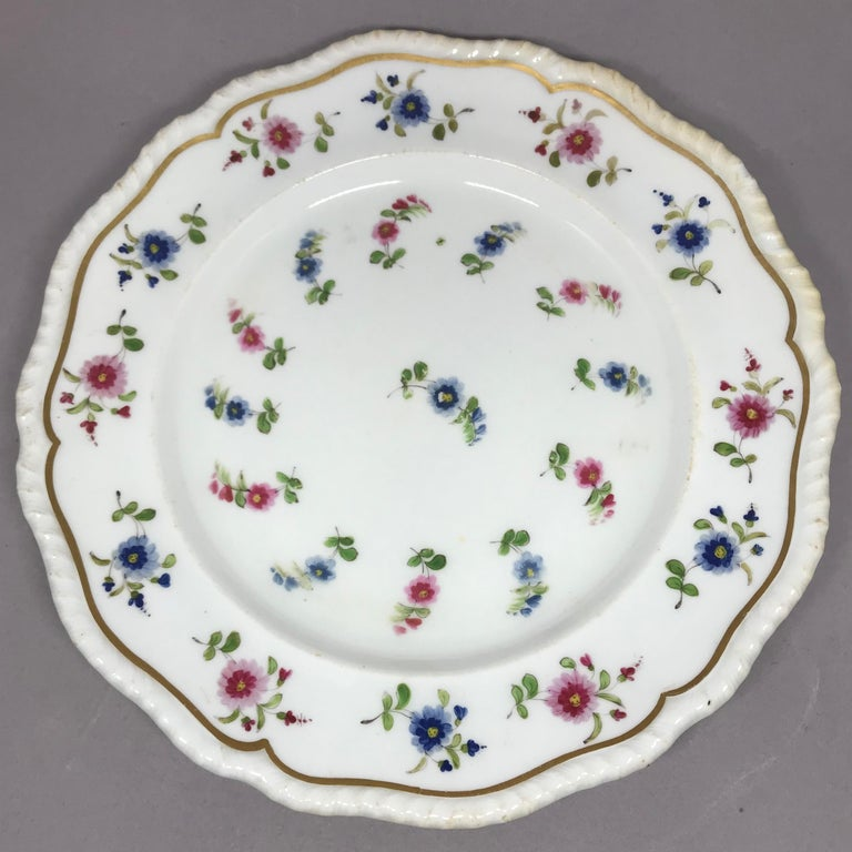 Hand-Painted Set of Eight Blue and Pink Floral Plates For Sale