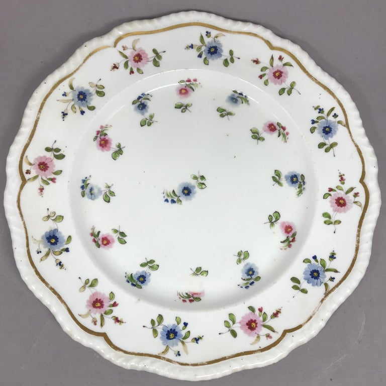 Porcelain Set of Eight Blue and Pink Floral Plates For Sale