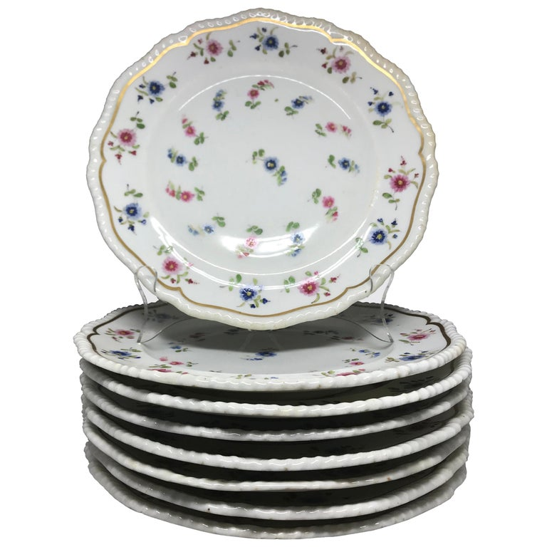 Set of eight blue and pink floral plates. Rope banded and gilt plates with blue and rose flowers with