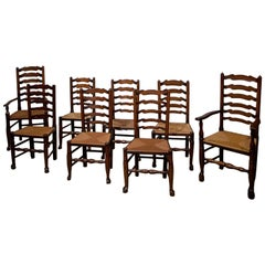 Set of Eight English Oak Ladder Back Chairs with Rush Seats