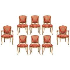 Set of Eight French 19th Century Louis XV Style Patinated Wood Dining Chairs
