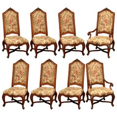 Set of Eight French Carved Walnut Dining Chairs and Armchairs