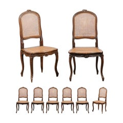 Set of Eight French Louis XV Style Walnut Side Chairs with Cane Seats and Backs