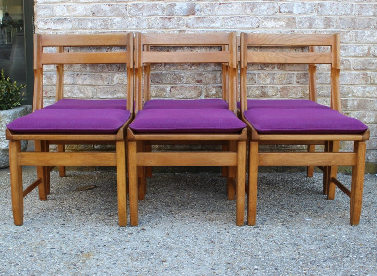 Set of eight oak dining chairs by Guillerme et Chambron... Original upholstery, two of the chairs not pictured.