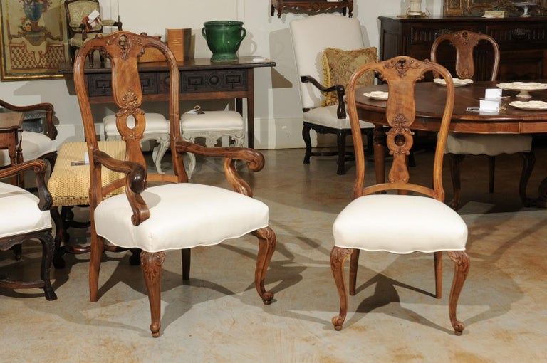 A Set Of Eight French Rococo Style Walnut Dining Room Chairs From The 19th Century