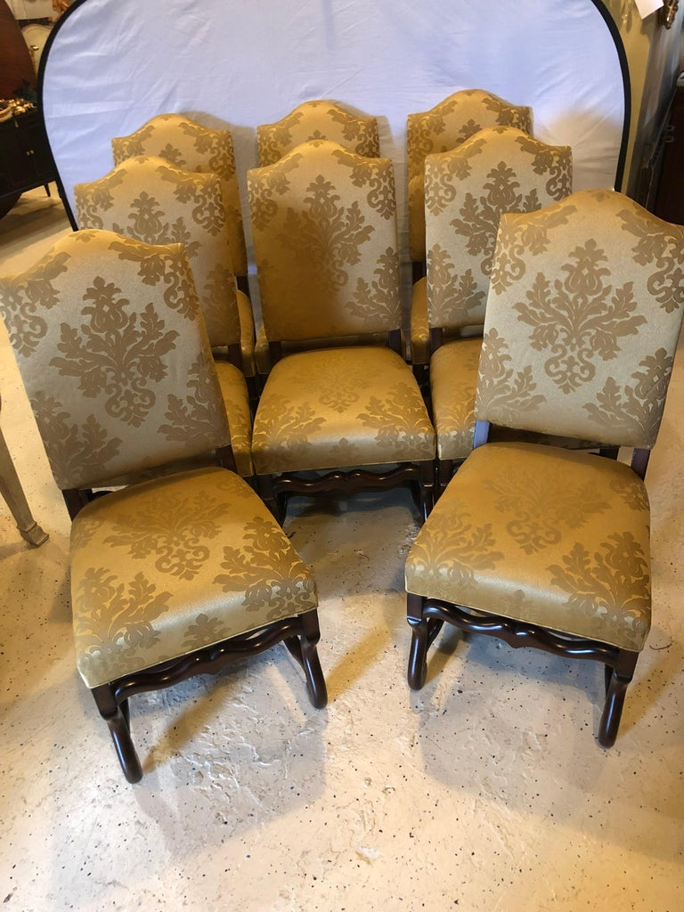 Set of eight Georgian style dining chairs. Each in a wonderful silkish style fabric with barley twist legs. 