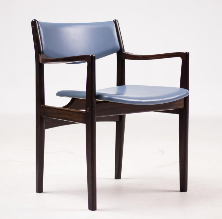 Beautiful set of eight armchairs by Danish designer Godtfred Petersen in mahogany and blue leather. 