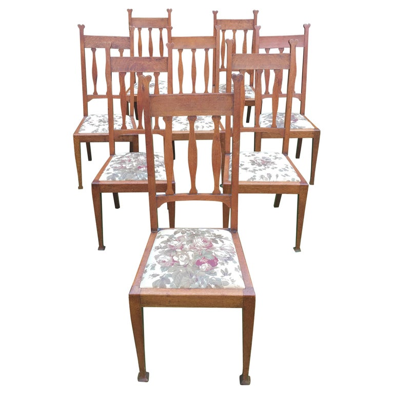 Set of Eight Golden Oak Arts & Crafts Dining Chairs Retaining the Original Label For Sale
