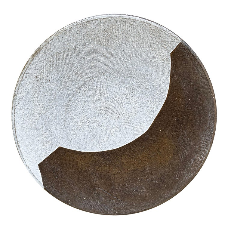 A fantastic set of eight hand-thrown dark brown stoneware dinner plates each with a unique bold white slip-glaze motif, and etched with a tool to add texture and a subtle sophisticated design.