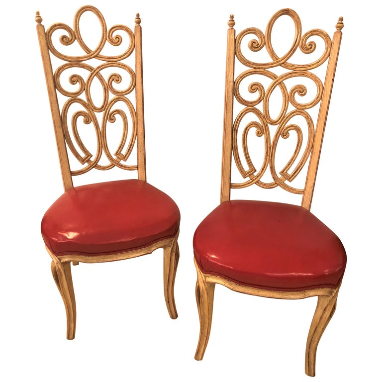 A fine set of eight Louis Pistono white distressed dining chairs. Each having a carved ribbon back with red under paint on a distressed off-white frame. This Fine set by the highly sought after furniture maker Louis Pistono (French/Canadian,