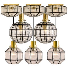 Set of Eight Iron and Clear Glass Light Fixtures by Limburg, circa 1965