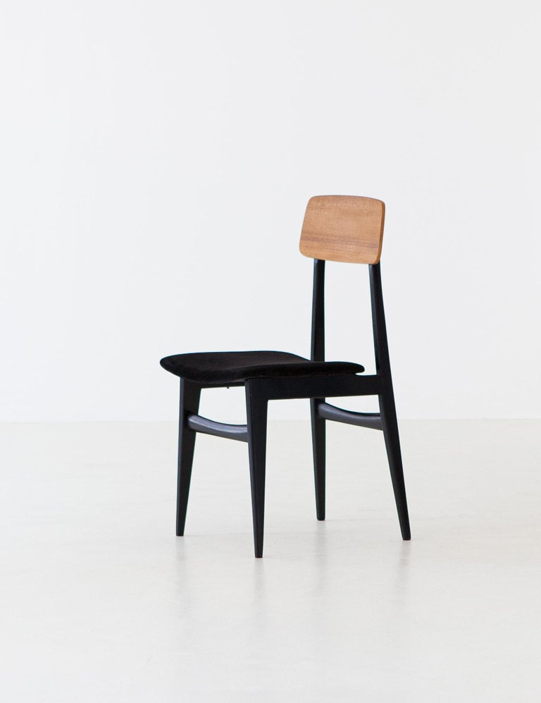 Set of 8 Mid-Century Modern chairs manufactured in Italy during the 1950s  Completely restored: new black suede Leather Wooden frame, sanded and black polished by hand with shellac teak-veneered backrest.