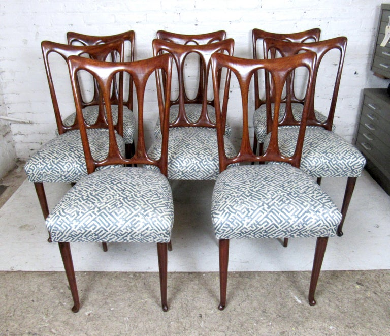 Mid-Century Modern set of eight Italian dining chairs with sleek upholstered seats.  Please confirm the item location (NY or NJ).