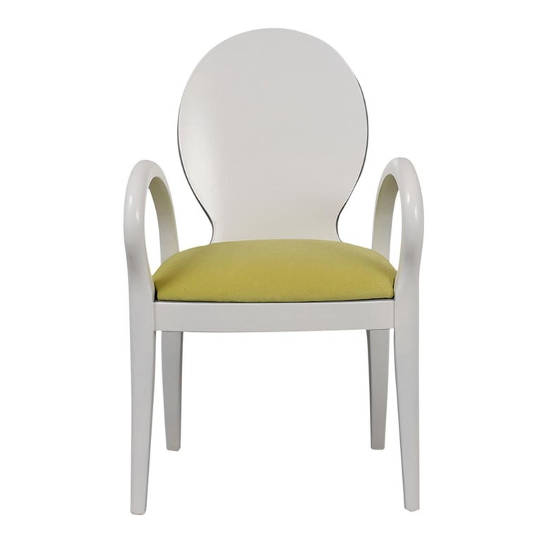 This Set of Eight Verde Modern Dining Chairs has been completely restored and is made from maple wood newly stained off-white lacquered finish with dark grey colored accents. This set comes with an oval backrest design, curved armrests and all the