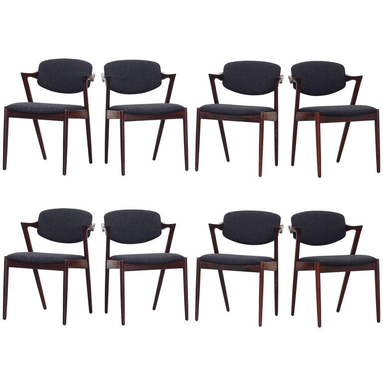 Set of eight Kai Kristiansen Dining Chairs Armchairs, S. Andersen New Upholstery For Sale