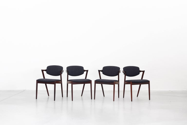Very beautiful set of eight dining chairs designed by Kai Kristiansen and produced by V. Schou Andersen, Denmark in 1964. The chairs are in a very good condition, all of them were newly reupholstered with a high quality fabric in dark grey by