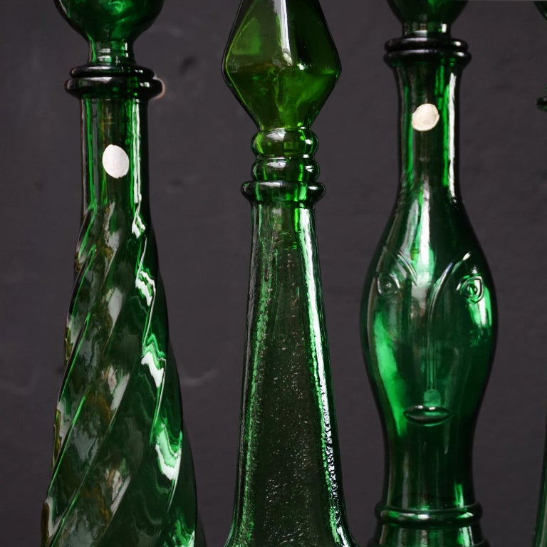 Mid-Century Modern Set of Eight Large Vintage Amber and Green Glass Empoli 'Genie' Decanters For Sale
