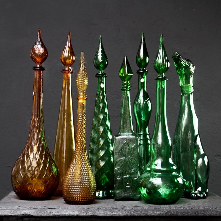 Mid-20th Century Set of Eight Large Vintage Amber and Green Glass Empoli 'Genie' Decanters For Sale