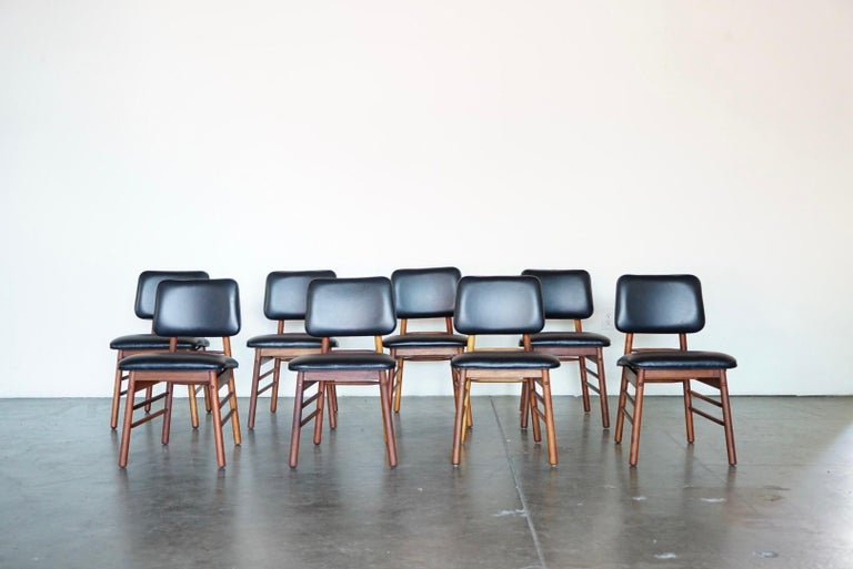 A gorgeous restored set of eight (8) dining chairs by Greta Grossman for Glenn of California. These Model 6260 chairs were designed in 1952 and produced in the early to mid-1950s. We fully restored each chair with high quality luxury black leather
