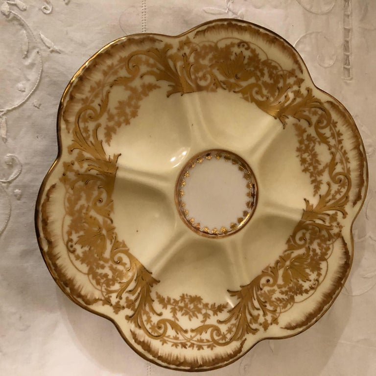 Rococo Set of Eight Limoges Oyster Plates with Profuse Raised Gold Decoration For Sale