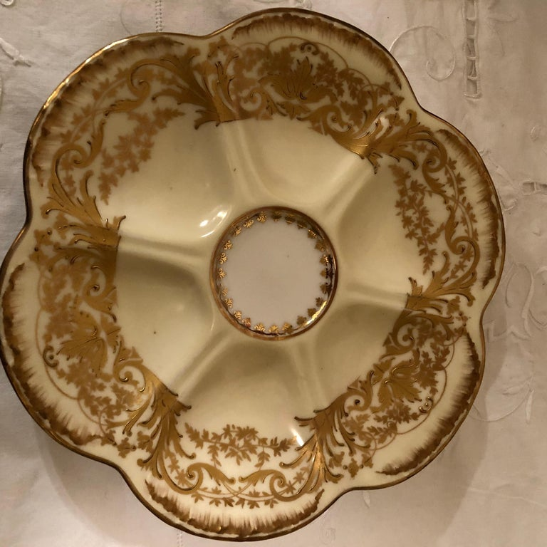 Set of Eight Limoges Oyster Plates with Profuse Raised Gold Decoration In Good Condition For Sale In Boston, MA