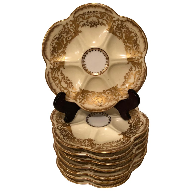 Set of Eight Limoges Oyster Plates with Profuse Raised Gold Decoration For Sale