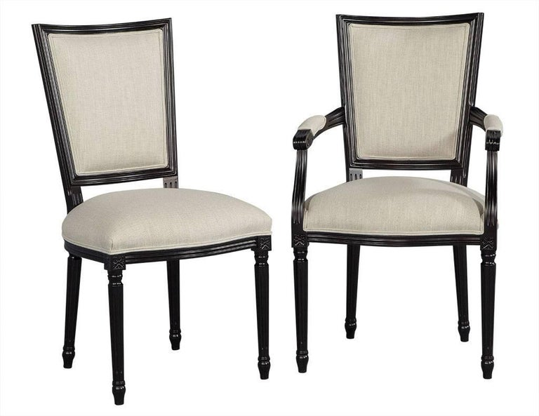 Set of eight Louis XVI style black lacquer dining chairs. This Louis XVI style dining chair set hails from Italy. Composed of beechwood frames hand-finished in a satin black lacquer and finished and reupholstered by our team in a Belgian linen,