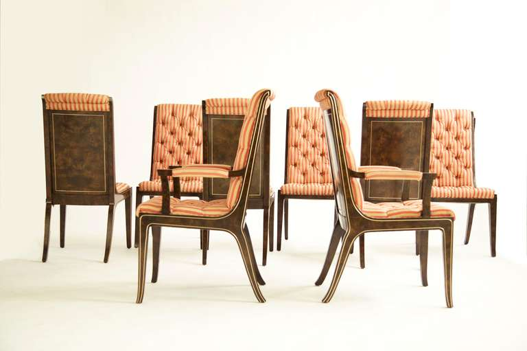 Mastercraft dining chairs for Widdicomb, six side chairs with two armchairs. Patched and bookmatched burled veneer, with extruded curved brass accents. Tufted upholstery would benefit from recovering.