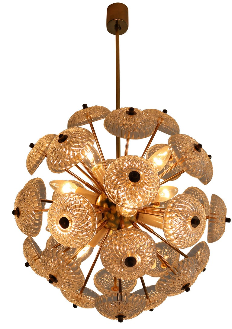 Set of eight midcentury brass floral chandeliers in the style of Emil Stejnar.   Made of brass with stylish floral glass disc glass light diffuses. The lamp is covered with art glasses which scatter the light in a unique and very charming way by