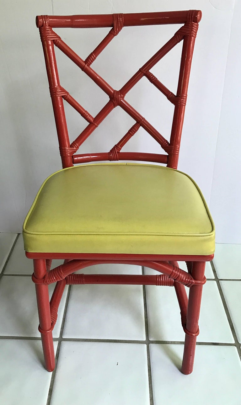 Exceptional set of eight bamboo Chinese Chippendale red chairs. Client purchased in 1970s from DIA. No hallmarks. Seat covers are vinyl and some have slight tearing at seams. There are two armchairs and six matching side chairs.
