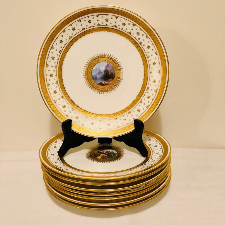 Look at the gorgeous hand painted scenes on this set of English Minton luncheon or dessert plates. The miniature paintings of the wonderful landscapes are painted by an extremely talented artist. The edges of the plates are embellished with small