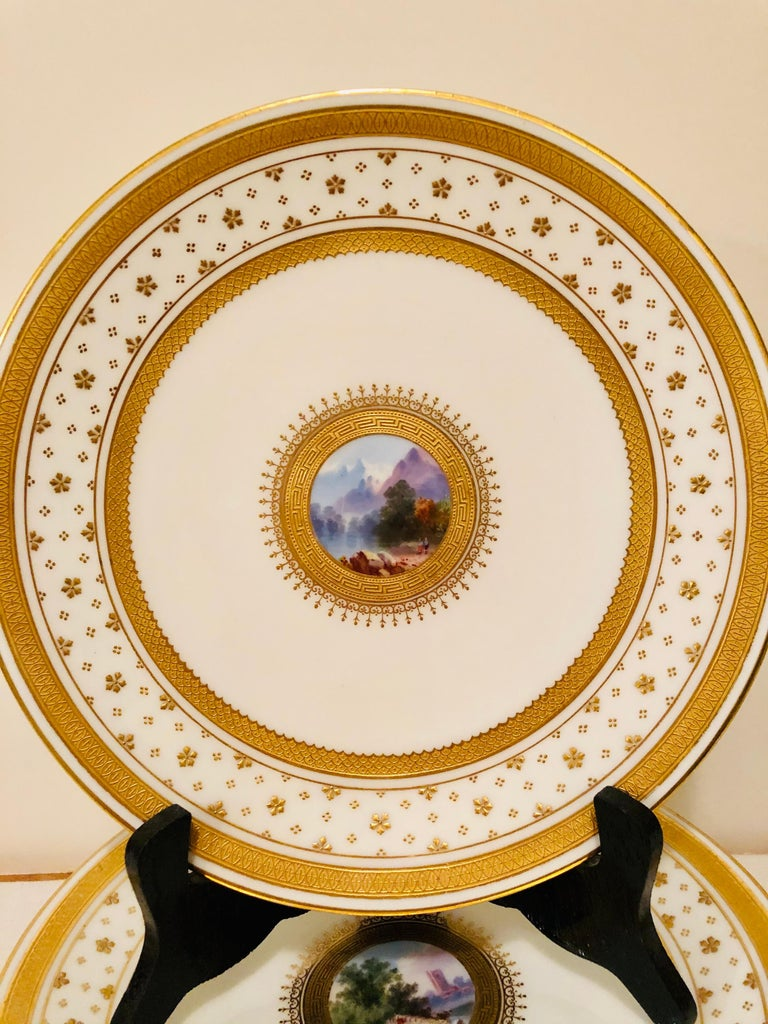 English Set of Eight Minton Plates Each Beautifully Hand Painted With a Different Scene For Sale