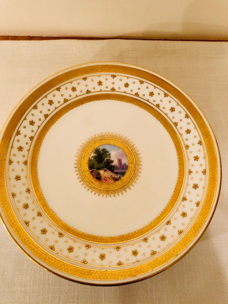 Set of Eight Minton Plates Each Beautifully Hand Painted With a Different Scene In Good Condition For Sale In Boston, MA