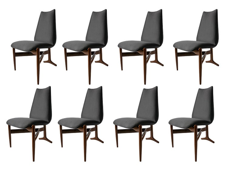 A unique set of 12 (twelve) Italian Modern chairs by Giuseppe Scapinelli. 3 legged chairs that are triangular in shape. The seat and back are upholstered and appear to be floating, over a Y-shaped wooden base. The rear leg, which extends along the