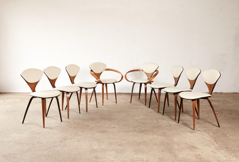 A set of eight original Norman Cherner pretzel dining chairs, made by Plycraft, USA in the 1960s. Bentwood frames. Newly upholstered in ivory vinyl. With makers label on one chair.