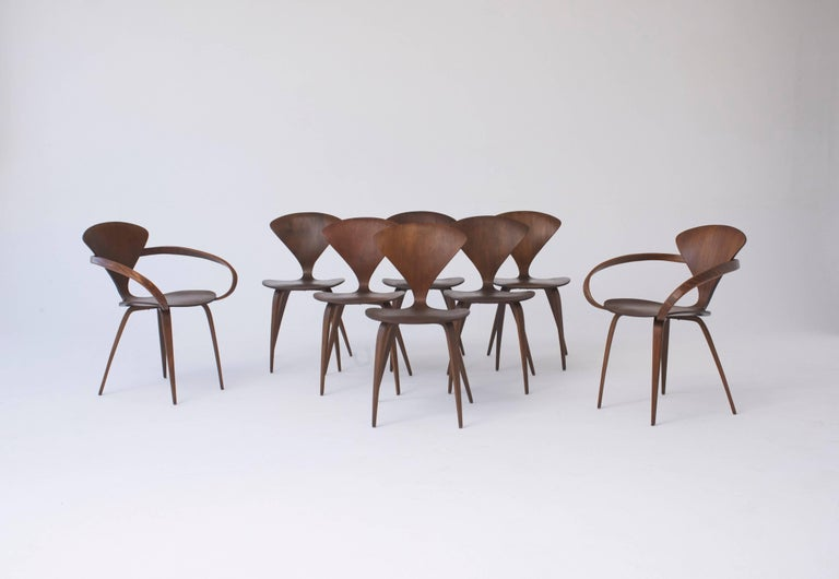 A rare full set of eight original Norman Cherner dining chairs, made by Plycraft USA in the 1960s. Six side chairs and two pretzel end chairs. Bentwood frames. Plycraft labels to the underside of all.