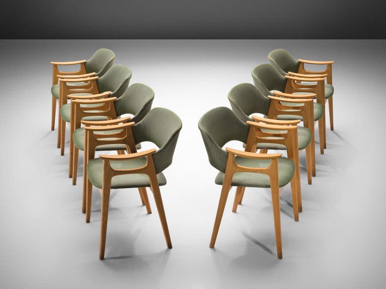 Set of eight chairs, in beech and green fabric, Norway, 1960s.