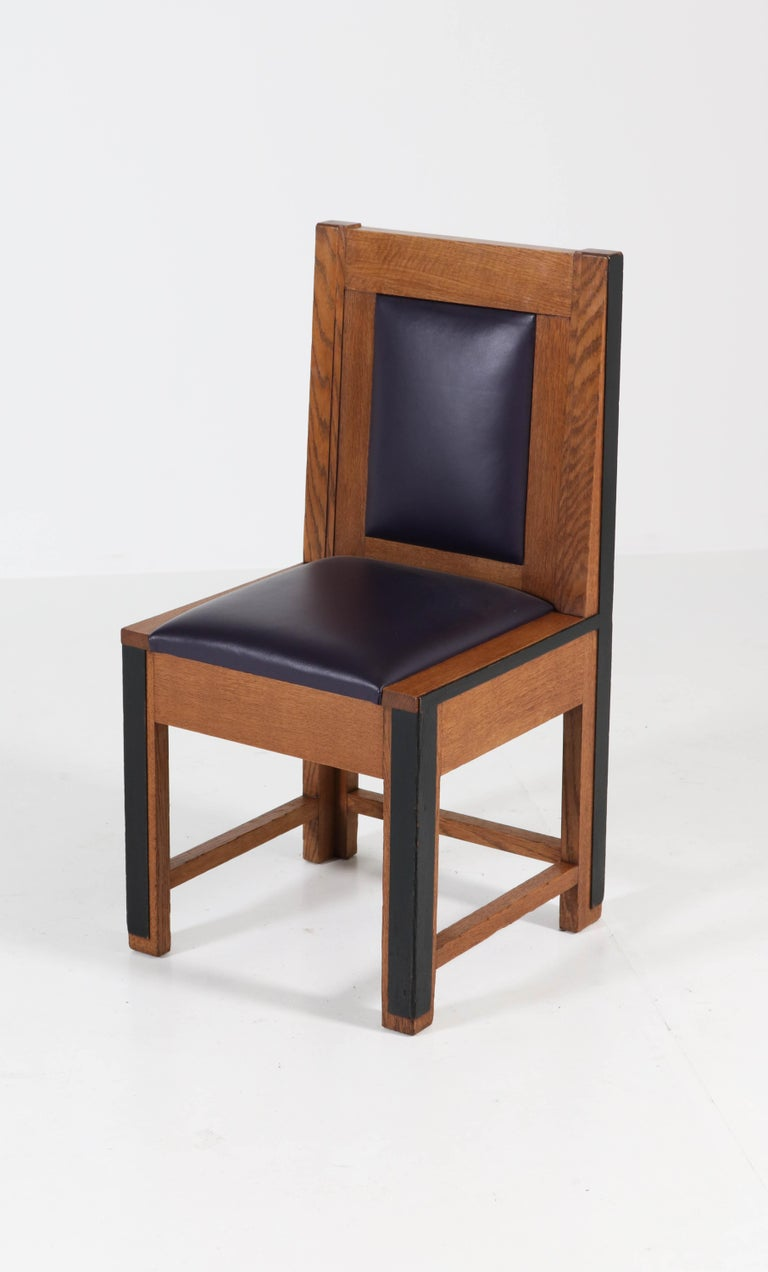 Stunning and rare set of eight Art Deco Haagse School chairs. Manufactured by Fa.Randoe for the City Hall of Haarlem. Striking Dutch design from the twenties. Re-upholstered with purple leather. In very good condition with minor wear consistent