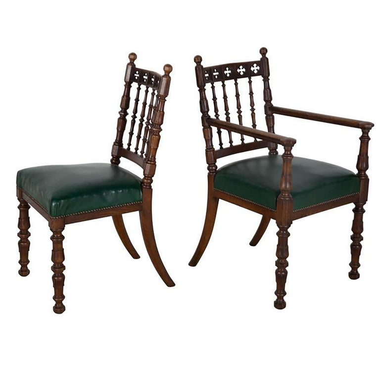 A set of eight 19th century oak dining chairs, with leather stuff over seats and carved quatrefoil top rails, these chairs and exceptional quality, the rake to the rear legs are wonderful. One carver chair made to match.
