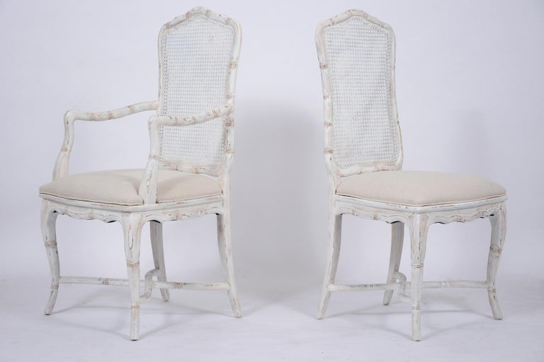 Carved Set of Eight Cane Dining Chairs For Sale