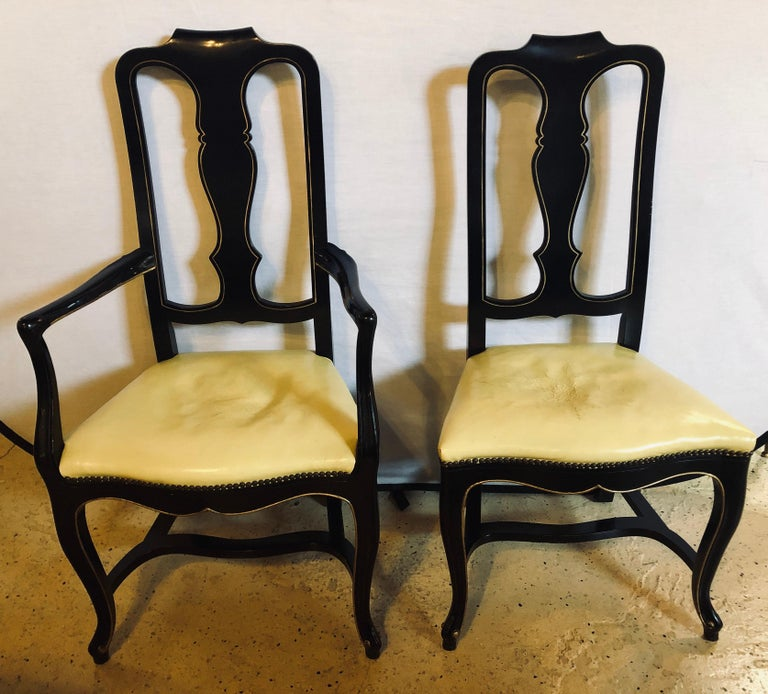 Set of eight Queen Anne style ebonized and gilt decorated dining chairs. These sleek and stylish dining chairs come straight from a NYC brownstone. The ebonized frames would fit easily in any Mid-Century Modern or Hollywood Regency setting. $800
