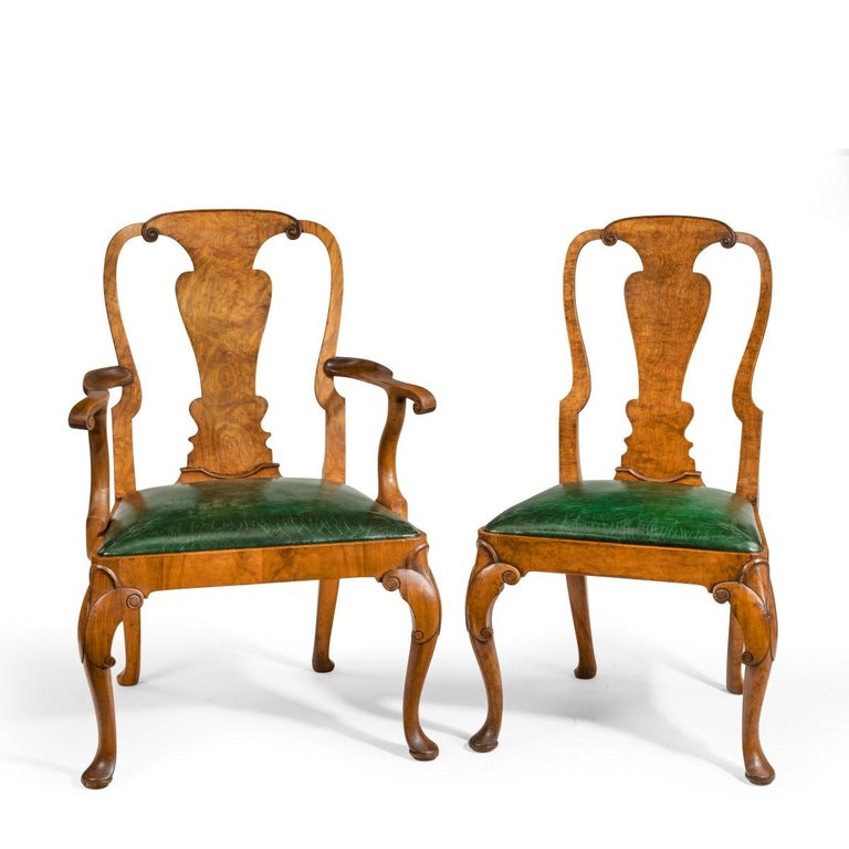 Fine set of eight Queen Anne style walnut and figured elm vase splat dining chairs, comprising two carvers and six side chairs, the backs with well-chosen figured elm splats above generous drop in seats, cabriole front legs, English, circa