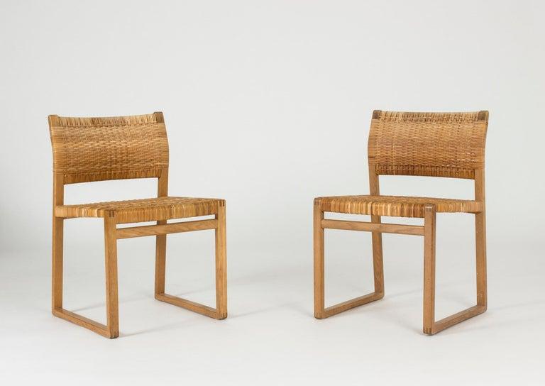 Scandinavian Modern Set of Eight Rattan Dining Chairs by Børge Mogensen For Sale