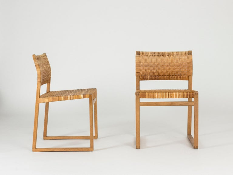 Danish Set of Eight Rattan Dining Chairs by Børge Mogensen For Sale