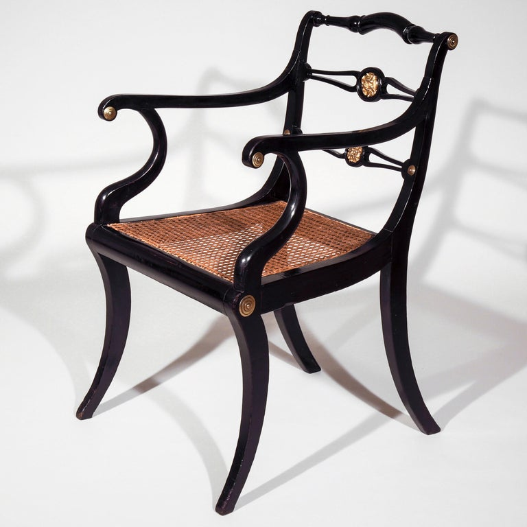 Ebonized Set of Eight Regency Black Lacquer Gilt-Brass Mounted Klismos Dining Chairs For Sale